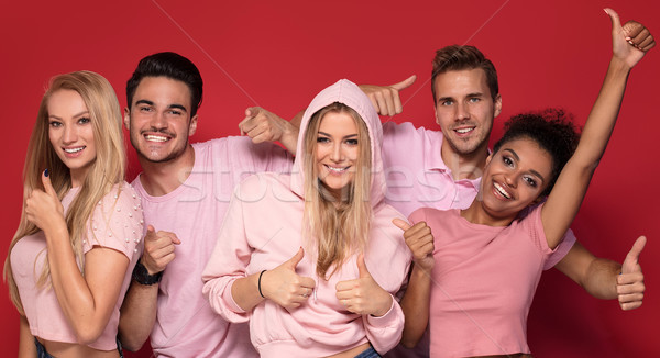 Group of beautiful friends posing together in studio. Stock photo © NeonShot