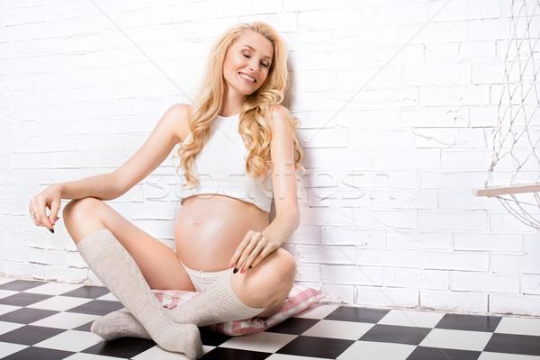 Beautiful pregnant woman posing. Stock photo © NeonShot
