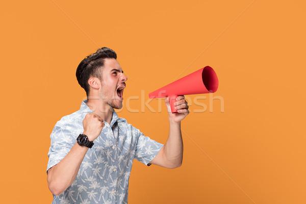 Bel homme mégaphone jeunes isolé orange Photo stock © NeonShot