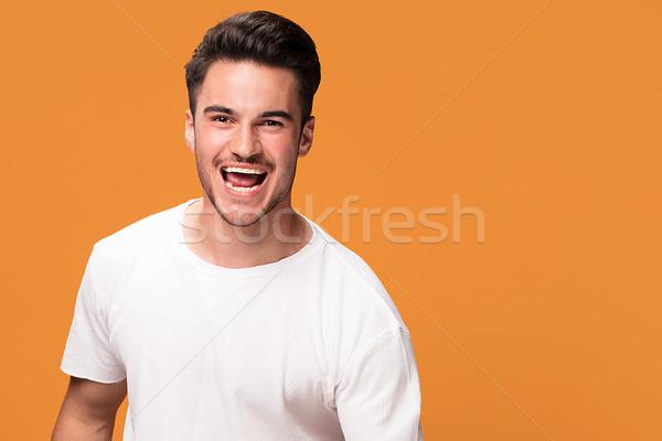 Felice bell'uomo giallo sorridere giovani Foto d'archivio © NeonShot