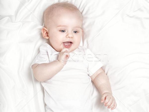 Felice piccolo baby ragazzo bianco foglio Foto d'archivio © NeonShot