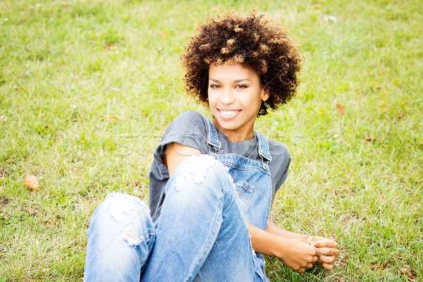 Young african american girl posing outdoor. Stock photo © NeonShot