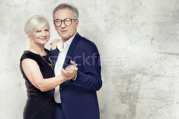 Belo casal de idosos posando juntos elegante roupa Foto stock © NeonShot