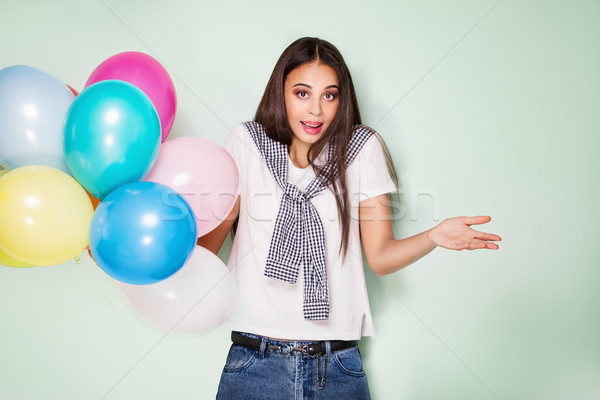 Happy young woman with balloons. Stock photo © NeonShot
