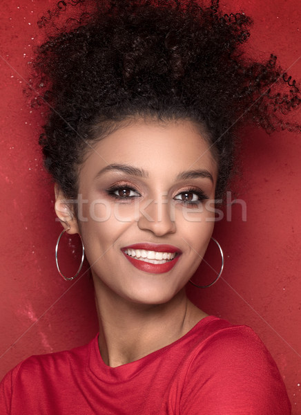 Portrait of beauty afro girl with toothy smile. Stock photo © NeonShot