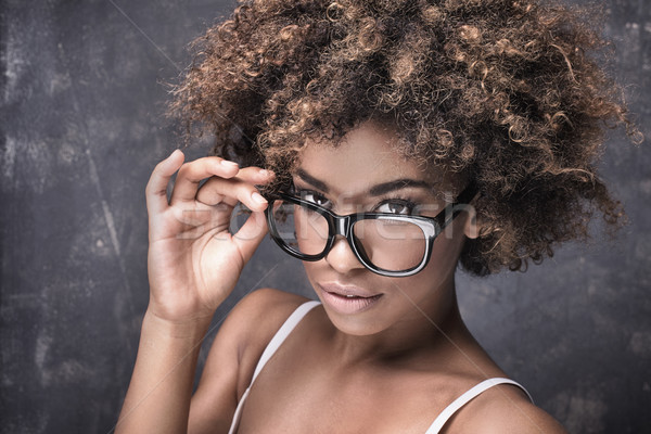 Girl with afro wearing eyeglasses. Stock photo © NeonShot