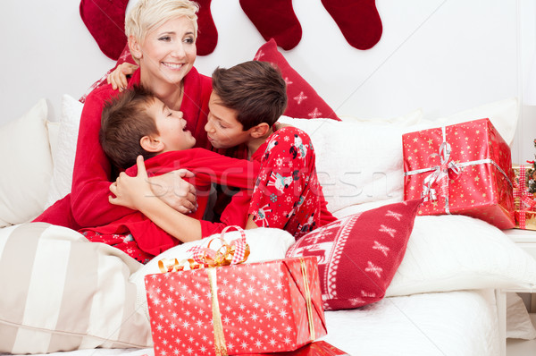 Pretty mother with sons, christmas time. Stock photo © NeonShot