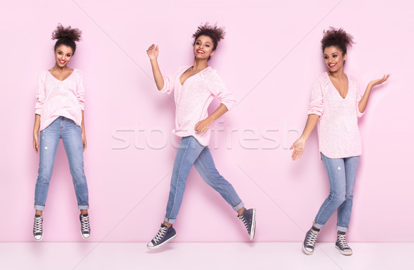 Happy afro girl with amazing smile posing on pink background. Stock photo © NeonShot