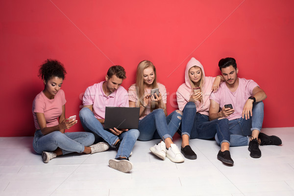 Young multiracial people with mobile phones. Stock photo © NeonShot