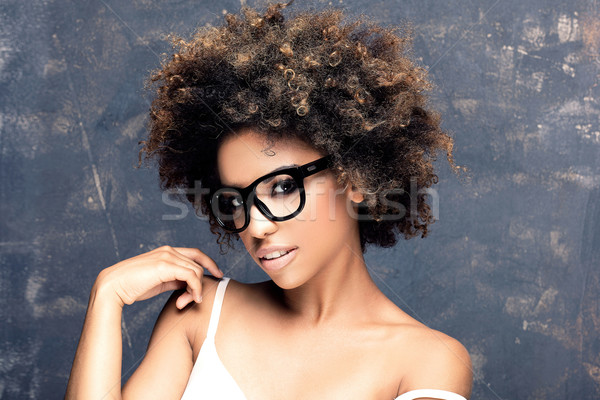 Portrait of young african girl with afro. Stock photo © NeonShot