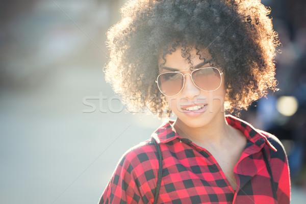 Fashionable young african american woman wearing sunglasses, urban scene. Stock photo © NeonShot