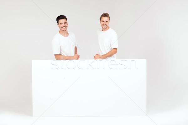 Due ragazzi posa bianco vuota bordo Foto d'archivio © NeonShot