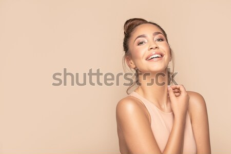 Blonde beauty posing with toothy smile. Stock photo © NeonShot