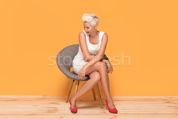 Beautiful middle aged woman smiling, relaxing. Stock photo © NeonShot