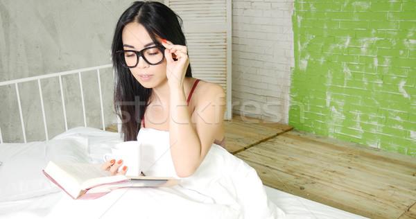 Young beautiful asian girl reading a book . Stock photo © NeonShot