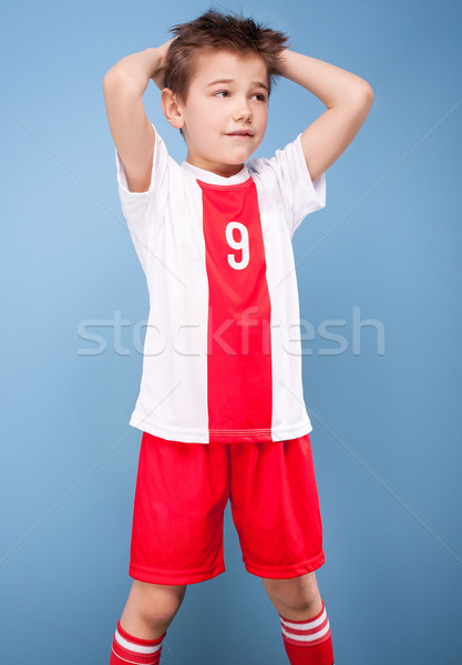 Young soccer player posing. Stock photo © NeonShot