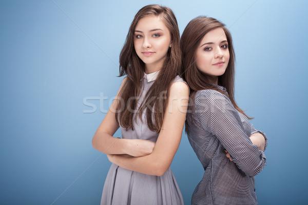 Jonge tienermeisjes studio mooie poseren Blauw Stockfoto © NeonShot