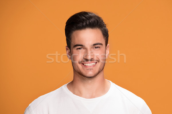 Portrait of handsome smiling man. Stock photo © NeonShot