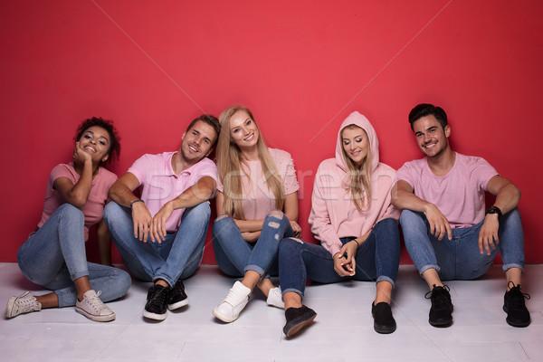 молодые люди улыбаясь расслабляющая привлекательный Сток-фото © NeonShot