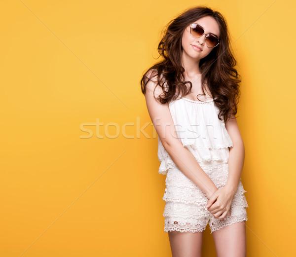 Genç güzel kız poz sarı esmer Stok fotoğraf © NeonShot