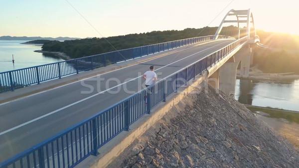 Male athlete training alone. Stock photo © NeonShot