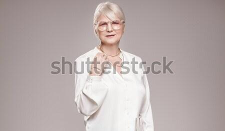 Elegant blonde beautiful middle aged lady posing . Stock photo © NeonShot