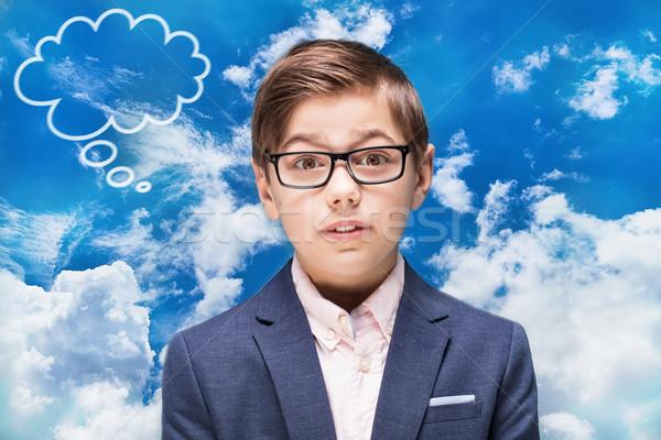 Smart мальчика очки мышления Kid позируют Сток-фото © NeonShot
