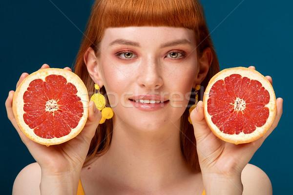 Lány grapefruit kék portré gyönyörű vörös hajú nő Stock fotó © NeonShot