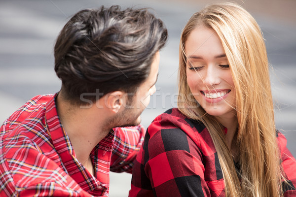 Smiling beautiful couple dating outdoors. Stock photo © NeonShot