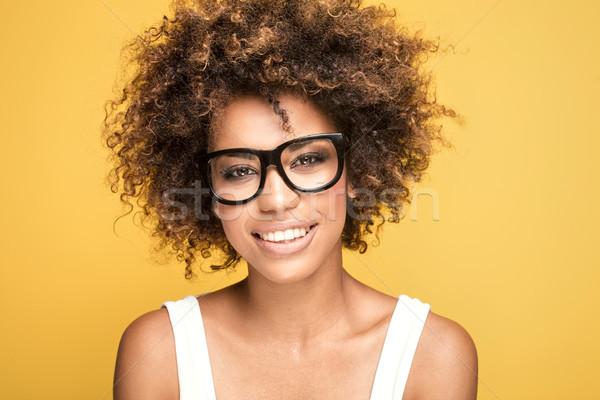African american girl wearing eyeglasses,smiling. Stock photo © NeonShot