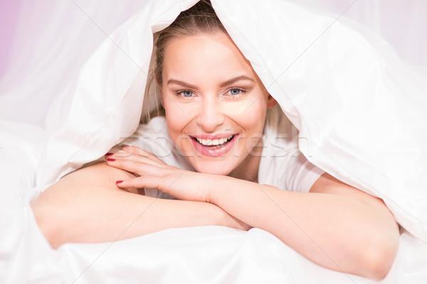 Beautiful young girl waking up. Stock photo © NeonShot