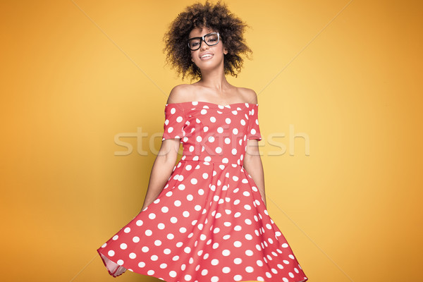 African american girl in red dress. Stock photo © NeonShot