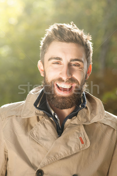 Smiling handsome young man outdoor. Stock photo © NeonShot