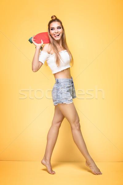Giovane ragazza skateboard donna Foto d'archivio © NeonShot