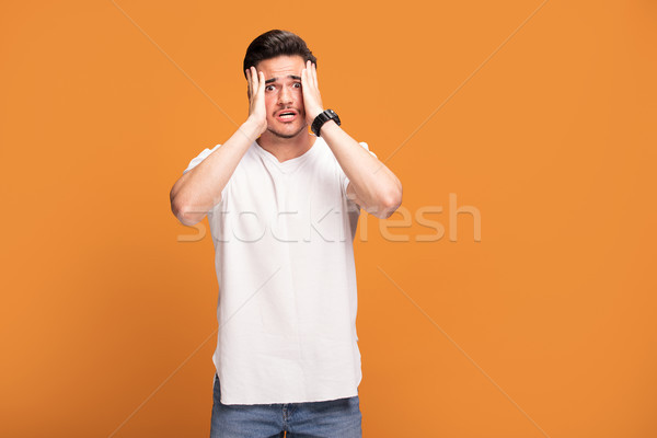 Disappointed young man on yellow background. Stock photo © NeonShot