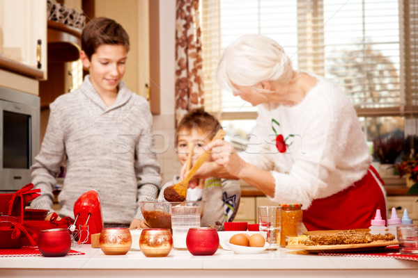 Grandmother with grandchilds in kitchen, christmas. Stock photo © NeonShot