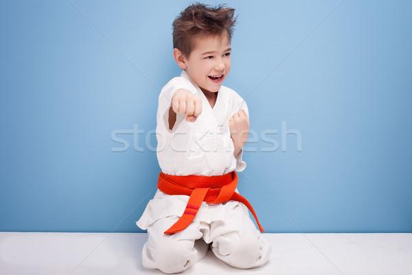мальчика каратэ костюм мало оранжевый пояса Сток-фото © NeonShot
