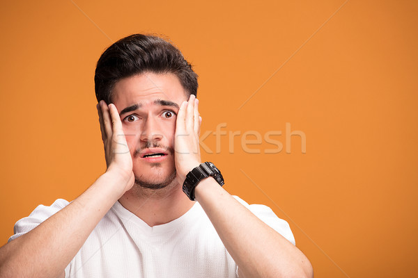Decepcionado joven amarillo guapo jóvenes hombre Foto stock © NeonShot