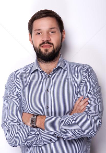 Stock photo: Handsome businessman in studio.