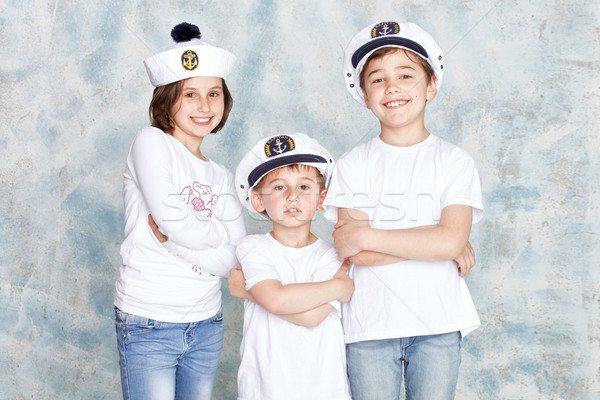 Smiling kids posing in studio. Stock photo © NeonShot
