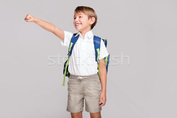 Mosolyog kicsi fiú hátizsák derűs gyerek Stock fotó © NeonShot
