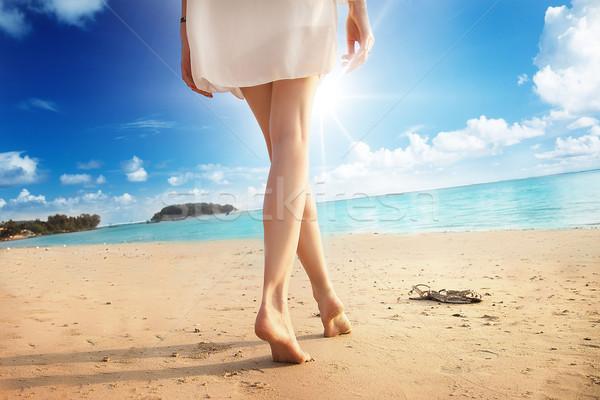 Woman legs on the beach.  Stock photo © NeonShot