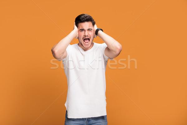 Rozczarowany młody człowiek żółty przystojny młodych człowiek Zdjęcia stock © NeonShot