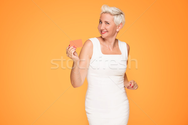 Middle aged woman posing with credit card. Stock photo © NeonShot