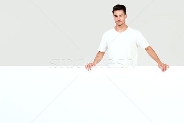 Man posing with white empty board. Stock photo © NeonShot