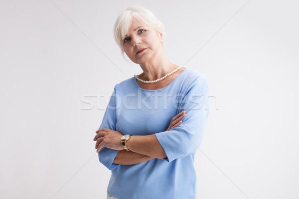 Good looking senior woman posing. Stock photo © NeonShot