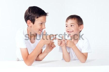Kettő kicsi fiútestvérek otthon pózol mosolyog Stock fotó © NeonShot
