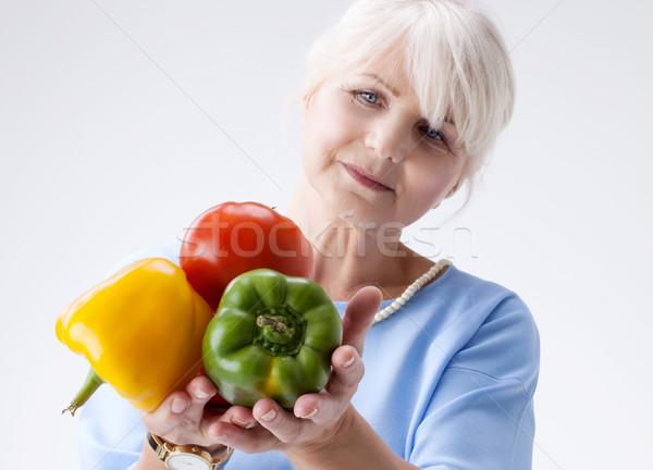 Senior woman with vegetables. Stock photo © NeonShot
