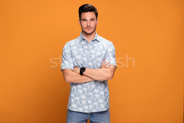 модный молодые красивый мужчина позируют молодым человеком желтый Сток-фото © NeonShot