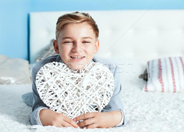 Young teenage boy with heart Stock photo © NeonShot